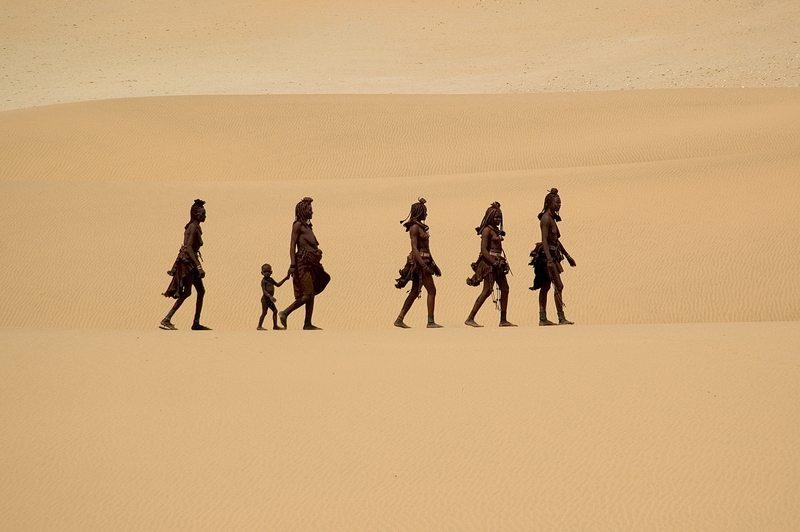 Himba tribe walking the Kaokoland dunes, the Skeleton Coast Namibia