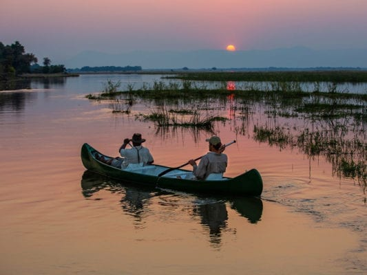 Canoeing the peaceful Zambezi on sunset - Mana Pools National Park